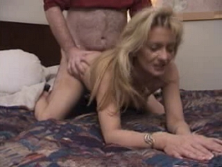 Blonde milf spreading her leg