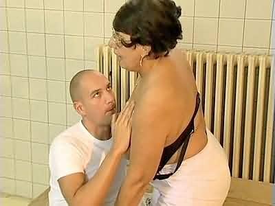 Old fat nurse helping patient