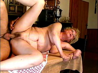 Fat blonde fucks on the table