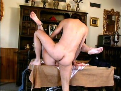 Big blonde stretched on table